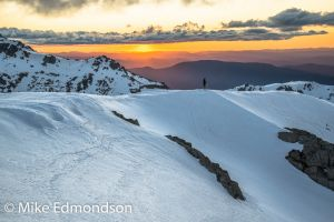 Skiers sunset   from Carruthers Peak