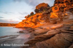 Brightly lit Painted Cliffs. Maria Island